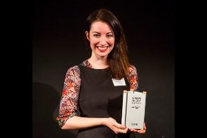Elena Dieckmann, CTO of Aeropowder with the Green Alley award trophy in her hands